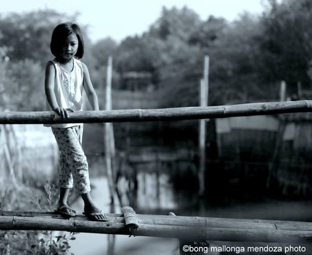 Girl on precarious walk BW