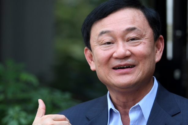 Thailand's former premier Thaksin Shinawatra gestures as he speaks to journalists outside his home in Dubai, after Puea Thai Party's Yingluck Shinawatra announced her coalition in Bangkok July 4, 2011. Exiled former Thai prime minister Thaksin said on Monday he had no wish to become prime minister again in the wake of a landslide election victory for his sister's opposition party. Thaksin, a billionaire twice elected premier, was ousted in a 2006 coup. (REUTERS/Jumana El Heloueh)